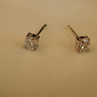 NEW Pair of .15 Carat Diamond stud earrings. VALUED $1,275