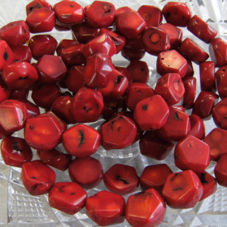 Unstrung dyed red coral beads