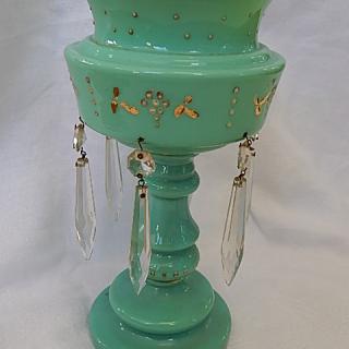 Green glass lustre vase