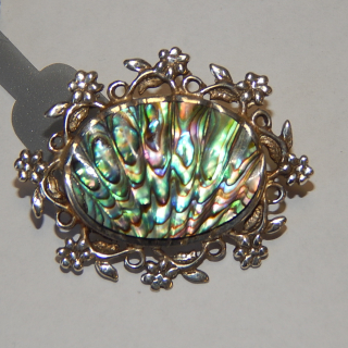 Sterling Silver OVAL Flower decorated brooch.