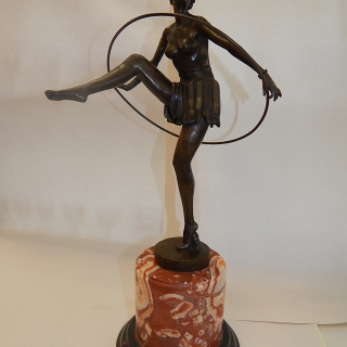 Bronze lady with hoop