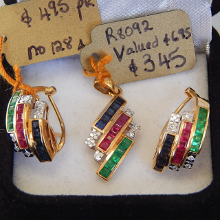 Diamond, Emerald, Ruby and Sapphire Pendant. Valued $695
