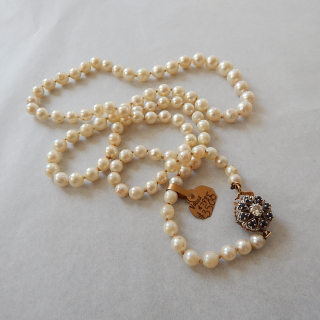 Cultured Pearl necklace with Diamond & Sapphire Clasp. Values $7885