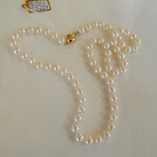 Knotted string of Pearls with a Gold and Diamond clasp