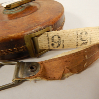 Brass and Leather Antique measure