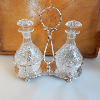 Antique EPNS Decantor stand with crystal Decantors
