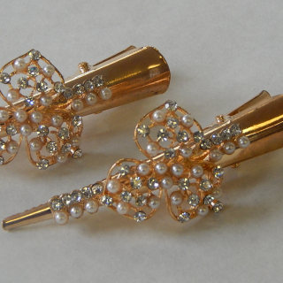 PAIR of Rose Gold coloured hair clips